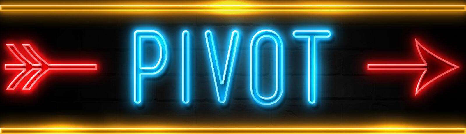 """""""Pivot"""" Neon Sign on brick wall"""